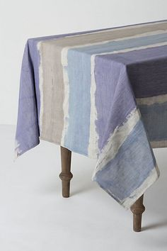 DIY this anthropologie tablecloth in greens and greys (use plain canvas and either fabric dye or watered down acrylics).