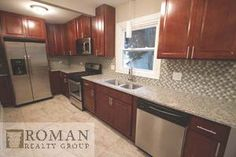 Checkout the this lovely kitchen by Roman Realty Group located in Aurora, IL. For more information please visit our website at www.romanrealty.com
