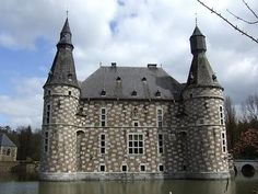 The Castle of Jehay is renowned for its checkerboard façade in white and brown stones. This beautiful Renaissance building dates back to the 16th century. It was the residence of the Counts van den Steen of Jehay since the end of the 17th century.  The interior houses a collection of fine antique furniture, sculptures, tapestry, paintings and other art objects. You can reach the garden by the bridge crossing the moat.  Amay, Belgium