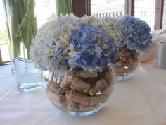wedding centerpieces for the bar; navy and white wedding; wine corks filled vases with hydrangeas (Bottle Centerpieces) Wine Cork Centerpiece, Bottle Centerpieces, Wedding Table Centerpieces, Flower Centerpieces, Flower Vases, Wedding Decorations, Wedding Ideas, Flowers Wine, Wedding Planning