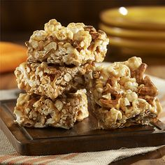 Salted Caramel Popcorn Bars: Sweet and salty popcorn bar recipe of popcorn and pretzel pieces coated with a yummy caramel-peanut butter glaze