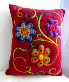 Felted pillow with raised flowers.