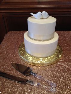 ivory ribbon and bling with bird topper Holiday Market Wedding Cakes, Royal Oak