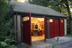 My extreme garage makeover. I replaced the old roll-up doors with carriage doors in one bay and a walk-out door in the other. A comfy plywood floor, high ceiling, and white walls with plenty of light make for an a nice place to work. It also didnt hurt that I bought a shed to house all of the non-woodworking items previously cluttering the shop.