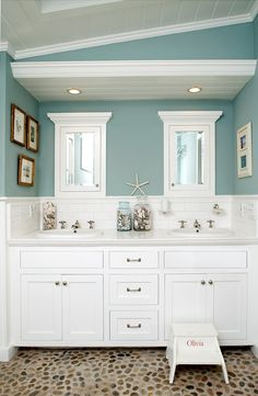 So much to like about this bathroom! The wall color, beadboard on the ceiling, the flooring, the moulding. All combine to give this a polished, coastal vibe. My take on coastal is less polished and more bohemian, but I still love this.