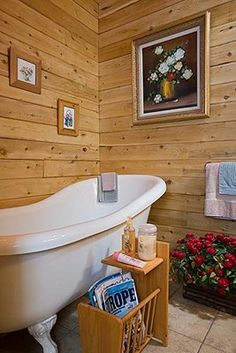 Log home bathroom featuring an old style tub.