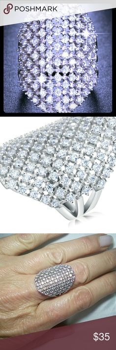 Large Cubic Zirconia Platinum Plated Cocktail Ring Large Cubic Zirconia Platinum Plated Cocktail Ring over Sterling silver, new, 1 in long, very beautiful, size 8 Jewelry Rings