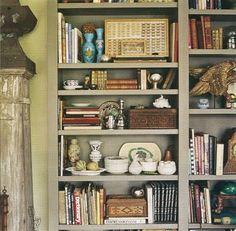 Gray-green bookshelves.