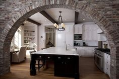 brick arch...black island...wood floors...beams...beautiful