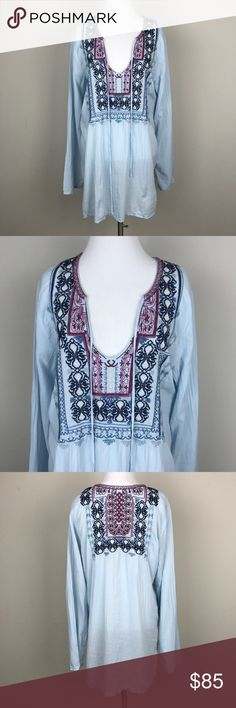 """[Johnny Was] Biya Embroidered Tunic Top Boho Blue Biya by Johnny Was Tunic top. Long sleeves. Keyhole tie neckline. Light blue with colorful embroidery.   🔹Pit to Pit: 20"""" 🔹Length: 31"""" 🔹Condition: Excellent pre-owned condition.  *Z3 Johnny Was Tops Tees - Long Sleeve"""