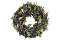 blue hydrangea blooms, purple sinuata, white larkspur, natural phalaris, mint flower and fern.