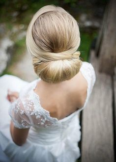 updo wedding hairstyle idea; photo: Winnie Baum Photography; via Knots Villa