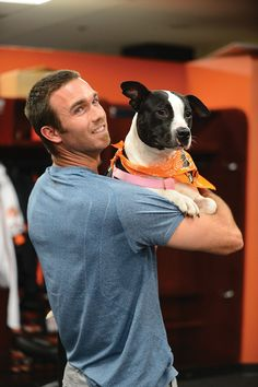 J.J. Hardy and Layla a pit bull terrier mix. | The Baltimore Orioles Brought Their Dogs To Work And It Was Adorable