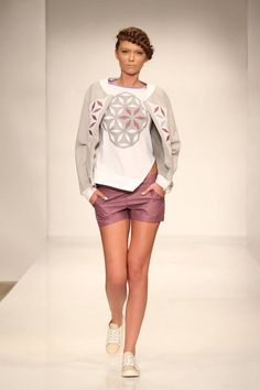 Grey bomber jacket with geometric white and purple flowers. Asymm etric white Tshirt with geometric grey and purple flower. Purple shorts. Order via facebook, pm or e-mail.