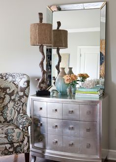 This silver leafed dresser is decorated to perfection. The power of a perfect vignette is undeniable. Another closeup just because it's so pretty.