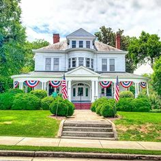 Southern Home Tour Historic Marietta Homes - Old southern mansion painted white. 4th of July home decor. Wrap around porch, double chimneys, rounded door transom, beautiful architectural details including Corinthian columns and dental molding #porch #porchdecor #porchideas #holidaydecorations #architecture #house #whitepaint #exteriordesign #southernlving #whitehouse #historichomes #exterior #architect #oldhouse #southern #mansions #architecturephotography #architecturelovers…