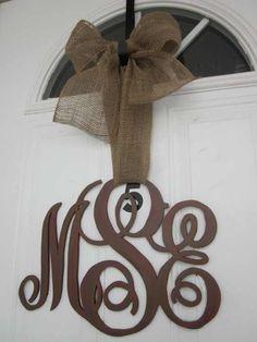 This monogram door idea is very popular where I live.