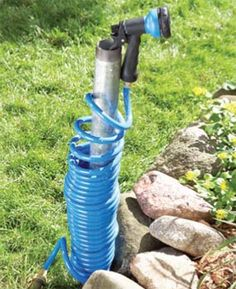 Use galvanized pipe to corral your hose.  Pound a 4-ft. length of galvanized steel pipe ($7 at home centers) into the ground, coil up to 50 ft. of hose around it and top the end with a nozzle that hooks into the pipe's end.