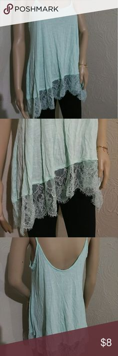 High low turquoise Top Freshman 1996 brand ..spaghetti strap top ..size medium ..from shoulder to bottom measures about 25 inches long ..armpit to armpit 18 inches wide  ..armpit to bottom of side measure about 23 inches long Freshman Tops Tank Tops