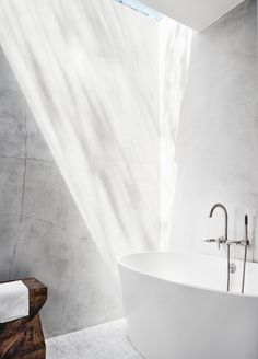Bathroom with skylight and concrete walls