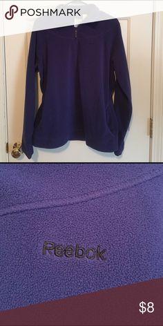 Reebok sweatshirt Purple Reebok sweatshirt with half zipper. With two pockets.Used in good condition. Reebok Sweaters