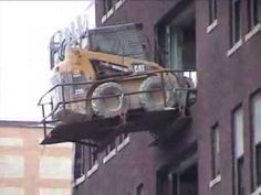 Crane picking a skid steer out of a building. Unsafe - YouTube