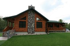 A log home's covered porches are outdoor living spaces In A Golden Eagle Log Home