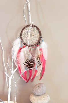 Each one of my dreamcatchers are handmade by me and a one of a kind. Every color scheme is carefully planned out and inspired by beautiful things. This particular dreamcatcher is very detailed. The beading is exquisite. Its hoop is wrapped in brown rawhide and measures to be 3.5 inches in diameter. its overall length is 11 inches long.