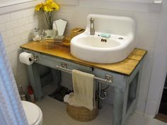 Erin Rodriguez of the blog Welcome Home scored both an old potting table from Craigslist and a salvaged sink from a local shop for her bathroom vanity. The pretty blue finish is another recycling win: it's from a 50-cent can of mis-tinted paint.