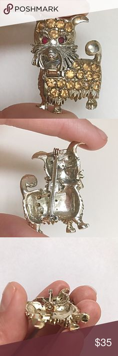 Vintage 1950s Scottie Dog Rhinestone Brooch🐶❤️ Adorable Midcentury Scottie dog that can't wait to be adopted! Citrine rhinestones adorn the body, and ruby rhinestones make the eyes! The whiskers are my fav! Condition: Very good vintage; general wear to metal; tarnish/finish loss to top of head as shown. No missing stones! Rollover clasp to back in perfect working condition. ❤️Don't forget: Reasonable offers are always welcome!!❤️ Vintage Jewelry Brooches