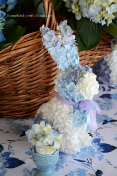 Easter table with hydrangea bunnies   floral bunny figures from Hobby Lobby, via Home Is Where the Boat Is