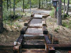 Railroad ties along side gravel. Use this for a path to the shed? I like how rustic it looks