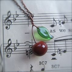 so sweet.  a little cherry necklace.