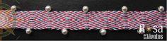 pulsera tejida en telar de tarjetas con balines de plata