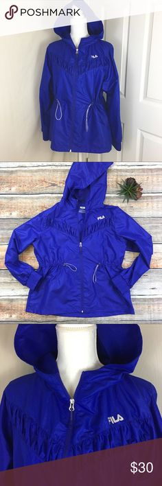 FILA | Blue Windbreaker Jacket Excellent like new condition. FILA blue with a slight shimmer & purple color.   *color is not exact to picture from my phone  •I LOVE OFFERS! ❤️ •If wrinkled, I will steam and prep before shipment!  •Need more pictures? ASK! ✨ •Fast shipping 📦 •Top rated seller ⭐️⭐️⭐️⭐️⭐️ •Packaged with care 💌 •10% discount on 2+ bundles 🛍 Fila Jackets & Coats