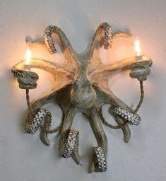 Make a statement with this Octopus Wall Sconce. No one can walk by this light fixture without saying WOW! Size measures aprx 18in Long x 16in wide x 7in tall (or out from the wall). Each piece is unique and completely handmade. Available in two colors; our traditional Mediterranean White