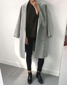 Super chic but simple ootd. Patent Chelsea boots cleverly paired with skinny black jeans that cut off above the ankle. Effortless vibes with a black blouse and matched with a broad, boxy shouldered wool grey jacket. The deep pockets are also convenient.