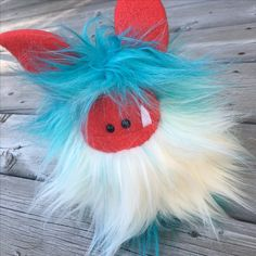 Firecracker is a limited edition Fuzzling waiting for adoption.