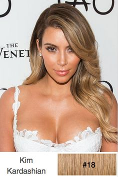 Kim Kardashian... These lovely highlighted locks are blow-waved beautifully and worn over one shoulder showing off the long layers cut into the sides and front to lighten the length. This smooth and sexy look is perfect for any special occasion.