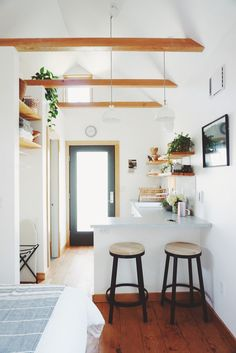 These barely there clear pendants would work.  Not distracting and keep it light and airy (especially for low ceilings...don't want anything pulling down an already low ceiling) Exposed beams in the Portland Tiny House