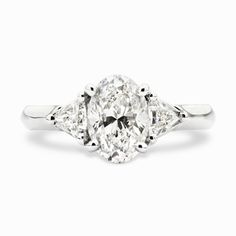 Oval and Trillion Cut Diamond Ring Made specifically to the aesthetic needs of one of our value clients, this dreamy engagement ring rocks an oval shaped, prong set diamond along side two outward [...]