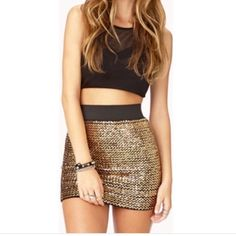 Gold sequence skirt Very cute mini skirt . In great condition. Price is firm ty Forever 21 Dresses Mini