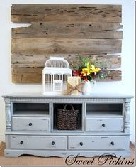 repurposed dressers for tv stands -  Actually I like the reclaimed wood on the wall...could be a nice backdrop for a flat screen on the wall.