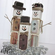 """How To Make A 2x4 Snowman Family       Cut out 8-2x4 blocks (2"""" x 3 1/2"""")  Sand the edges with an electric sander, giving them a chunky look.  Paint the blocks.  Vanilla from JoAnn Fabrics is a nice color."""