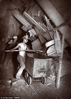 Work: A bare-chested man works at a mining shaft  On link: Rare early flash photography images of Cornish miners digging for tin in 1890s reveal the perilous conditions in which they toiled.