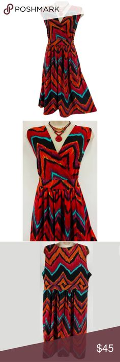 """1X 16 XXL ABSTRACT CHEVRON PRINT DRESS Plus Size This gorgeous abstract chevron print dress is sexy, trendy, & fashionable!   Size: 1X Slip on/off Surplice neckline  Gorgeous abstract chevron print in red, orange, purple aqua, green, & black Stretchy, comfortable fabric Measurements: Bust (armpit to armpit):  44"""" relaxed - stretches to 56"""" Waist: 38"""" relaxed - stretches to 48"""" Hips:  60"""" relaxed Length: 39.5"""" (top of shoulder to bottom hem)  Condition: PRISTINE CONDITION! Fabric Content: 95%…"""
