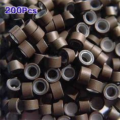 TOOGOO(R) 200 PCS 5mm Medium brown Silicone Lined Micro Rings Links Beads For I Tip Bonded Feather Hair Extensions. Type: Silicone-lined Micro Rings. Color: Medium Brown. Material: Aluminum & Silicone. Quantity: 200 pcs. Size: 5 mm Outside Diameter, 3.5 mm Inside Diameter, 4 mm Length.