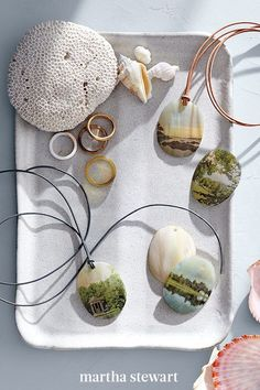 A seashell pendant makes a lovely natural backing for landscape photos. The images take on a dreamy, painterly quality when printed on decal film and smoothed onto the shells. Thread them with leather cord for necklaces. #marthastewart #crafts #diyideas #easycrafts #tutorials #hobby