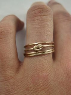 skinny gold stacked, with a knot.