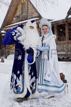 Russian Christmas characters Ded Moroz Father Frost and Snegurochka Snow Maiden with gifts bag near  Stock Photo
